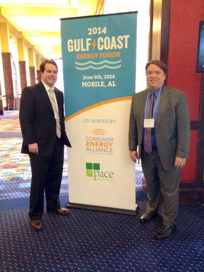 CEA-Florida Executive Director (right) readies for the Gulf Coast Energy Forum with event partner Lance Brown, Executive Director for PACE – Partnership for Affordable Clean Energy.