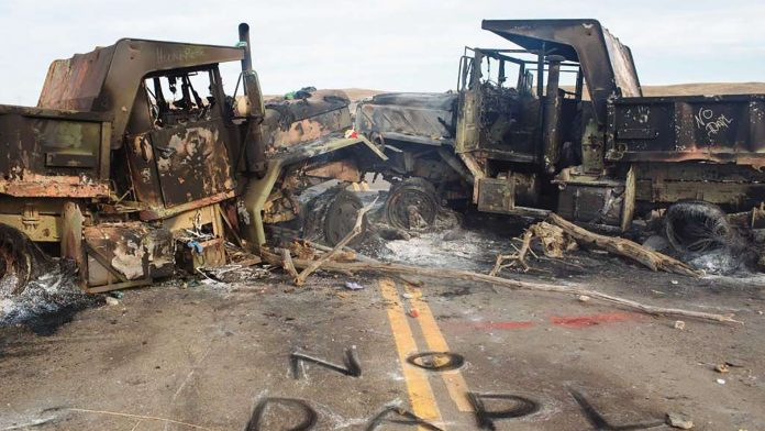 Pipeline protesters barricade highway and burn trucks