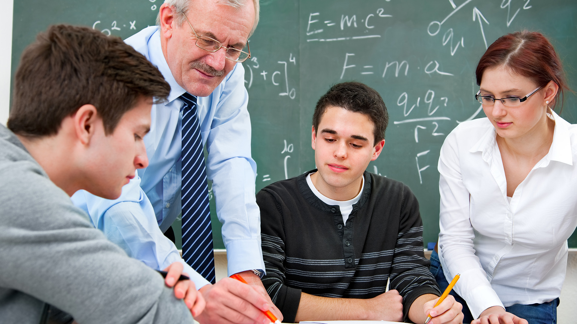 High school students with teacher learning math - Consumer Energy ...