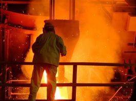 Steel mill worker over furnace