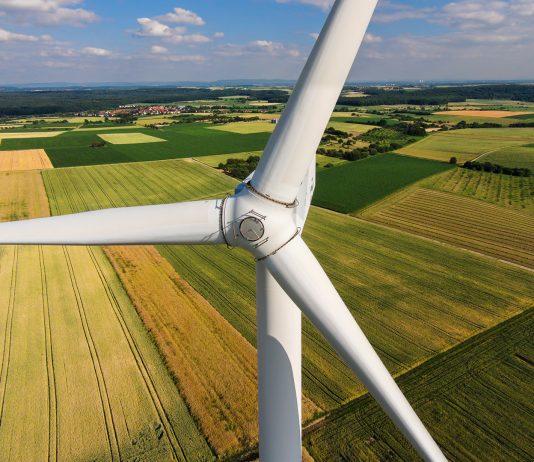 Wind turbine in farm field