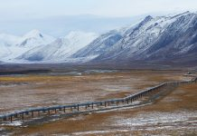 Oil pipeline in Alaska with mountain range