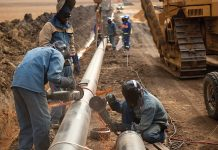 Laborers working on pipeline
